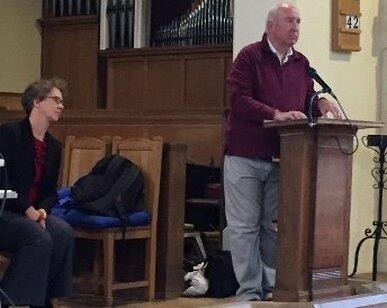 Chairman Mark Weller addresses the meeting, with Barbara Eifler (Chief Exec of Making Music) close by,